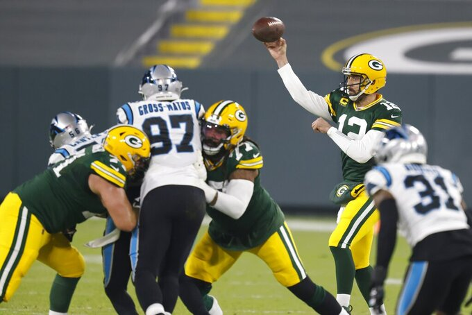 Green Bay Packers' Aaron Rodgers throws during the first half of an NFL football game against the Carolina Panthers Saturday, Dec. 19, 2020, in Green Bay, Wis. (AP Photo/Matt Ludtke)
