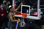 Baylor guard Jordan Turner cuts down the net after the championship game against Gonzaga in the men's Final Four NCAA college basketball tournament, Monday, April 5, 2021, at Lucas Oil Stadium in Indianapolis. Baylor won 86-70. (AP Photo/Michael Conroy)