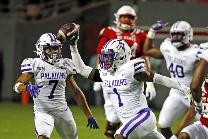 Furman's Travis Blackshear (1) recovers a fumble by North Carolina State's Zonovan Knight (7), not pictured, with teammate DiMarcus Clay (7) looking on during the first half of an NCAA college football game in Raleigh, N.C., Saturday, Sept. 18, 2021. (AP Photo/Karl B DeBlaker)