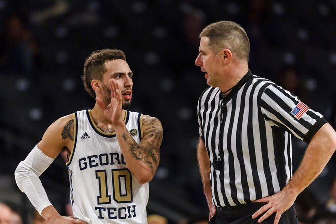 Georgia Tech guard Jose Alvarado (10) speaks with an official during the second half of the team's NCAA college basketball game against Pittsburgh on Wednesday, Feb. 20, 2019, in Atlanta. Georgia Tech won 73-65. (AP Photo/Danny Karnik)