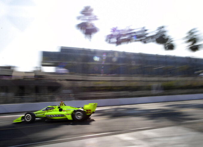 Indycar driver Simon Pagenaud, from France, makes the turn onto Seaside Way from Pine Avenue during the final practice session for the Grand Prix of Long Beach auto race Saturday, Sept. 25, 2021, in Long Beach, Calif. (Will Lester/The Orange County Register via AP)