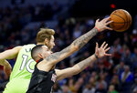 Houston Rockets guard Austin Rivers and Minnesota Timberwolves forward Jake Layman (10) in the first quarter during an NBA basketball game Saturday, Nov. 16, 2019 in Minneapolis. (AP Photo/Andy Clayton- King)
