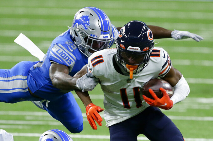 Detroit Lions safety Will Harris (25) dives to tackles Chicago Bears wide receiver Darnell Mooney (11) in the first half of an NFL football game in Detroit, Sunday, Sept. 13, 2020. (AP Photo/Duane Burleson)