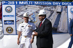 Shipyard Commander Capt. Dan Ettlich, left, and Navy Secretary Carlos Del Toro, attend a groundbreaking ceremony for a $1.7 billion dry dock project at Portsmouth Naval Shipyard, Wednesday, Sept. 8, 2021, in Kittery, Maine. King is recovering from COVID-19. (AP Photo/Robert F. Bukaty)