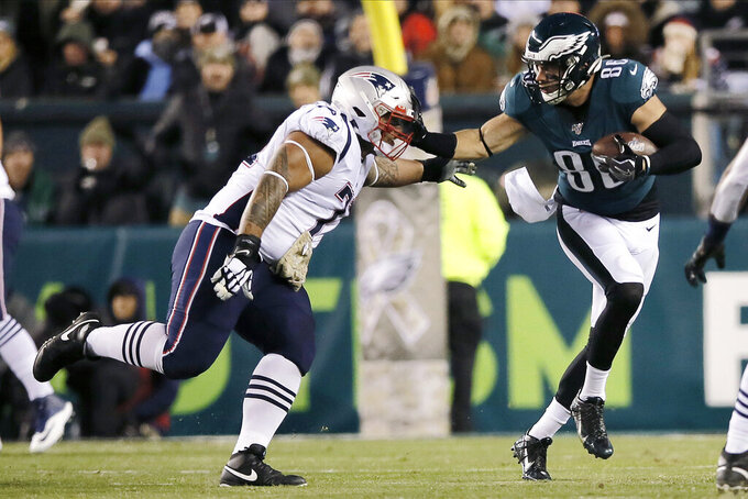 Philadelphia Eagles' Zach Ertz, right, tries to slip past New England Patriots' Danny Shelton during the first half of an NFL football game, Sunday, Nov. 17, 2019, in Philadelphia. (AP Photo/Michael Perez)
