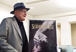 """FILE - In this Wednesday, July 22, 2015 file photo, Branko Lustig stands next to a poster of the film Schindler's List at Yad Vashem Holocaust memorial in Jerusalem. Lustig, one of the producers of Schindler's List, presented his Academy Award to Yad Vashem Holocaust memorial on Wednesday, saying it had found its rightful resting place. Lustig, an Oscar-winning Croatian film producer and Holocaust survivor, has died at 87. The Yad Vashem center in Jerusalem said Lustig died Thursday, Nov. 14, 2019 in Zagreb, the capital of his native Croatia. Lustig is best known for winning Academy Awards for Best Picture for Steven Spielberg's """"Schindler's List"""" and for Ridley Scott's """"Gladiator."""" (Nir Elias/Pool Photo via AP, file)"""