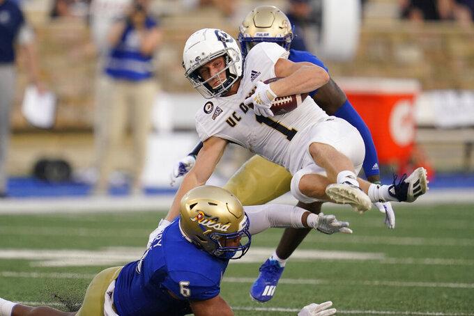 UC Davis wide receiver C.J. Hutton (1) tries to get past Tulsa cornerback Kenney Solomon (5) during the first half of an NCAA college football game Thursday, Sept. 2, 2021, in Tulsa, Okla. (AP Photo/Sue Ogrocki)