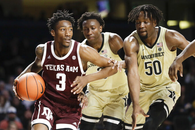 Texas A&M guard Quenton Jackson (3) drives against Vanderbilt defenders Saben Lee, center, and Ejike Obinna (50) in the first half of an NCAA college basketball game Saturday, Jan. 11, 2020, in Nashville, Tenn. (AP Photo/Mark Humphrey)