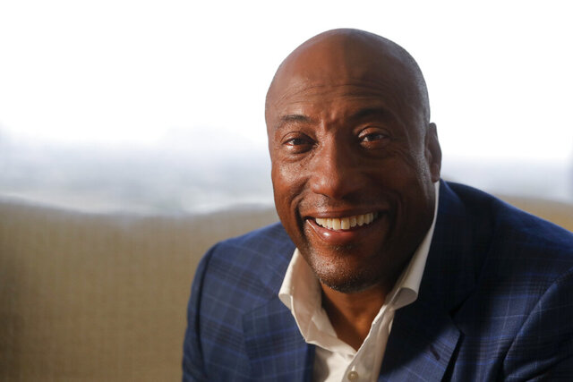 FILE - In this Sept. 5, 2019 file photo, comedian and media mogul Byron Allen poses for a picture in Los Angeles. Allen and Comcast have settled a long-running a long-running racial discrimination dispute, and the cable giant will add three of the black media mogul's channels to its cable packages.  (AP Photo/Chris Carlson, File)