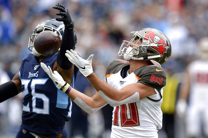 Tampa Bay Buccaneers wide receiver Scott Miller (10) catches a pass as he is defended by Tennessee Titans cornerback Logan Ryan (26) in the first half of an NFL football game Sunday, Oct. 27, 2019, in Nashville, Tenn. (AP Photo/Mark Zaleski)
