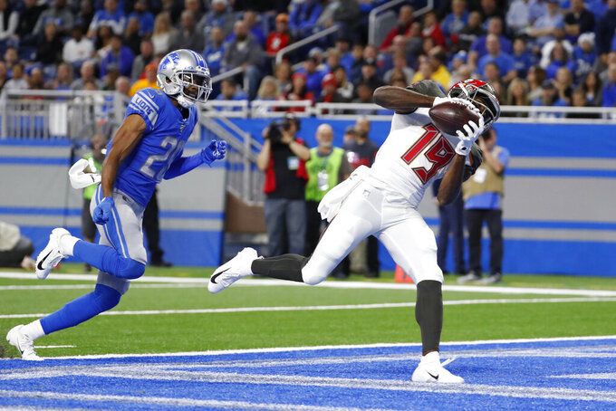 Tampa Bay Buccaneers wide receiver Breshad Perriman (19), defended by Detroit Lions cornerback Rashaan Melvin (29), catches a 34-yard pass for a touchdown during the first half of an NFL football game, Sunday, Dec. 15, 2019, in Detroit. (AP Photo/Rick Osentoski)