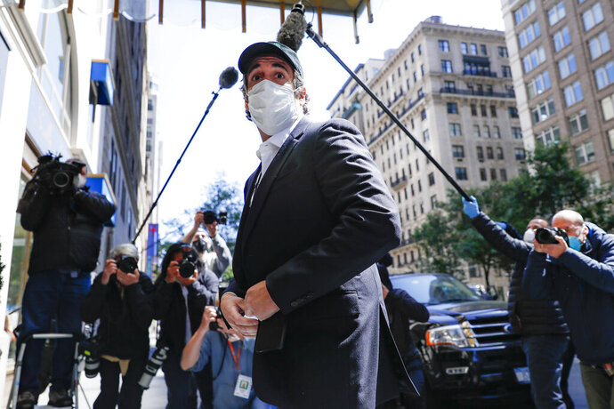 Michael Cohen arrives at his Manhattan apartment, Thursday, May 21, 2020, in New York. President Donald Trump's longtime personal lawyer and fixer was released federal prison Thursday and is expected to serve the remainder of his sentence at home. Cohen has been serving a federal prison sentence at FCI Otisville in New York after pleading guilty to numerous charges, including campaign finance fraud and lying to Congress. (AP Photo/John Minchillo)
