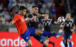 Chile's Sebastian Vegas, left, works against Argentina's Lautaro Martinez during the first half of an international friendly soccer match Thursday, Sept. 5, 2019, in Los Angeles. (AP Photo/Marcio Jose Sanchez)