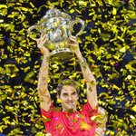 FILE - In this Oct. 27, 2019, file photo, Switzerland's Roger Federer holds the trophy aloft after winning his tenth title at the Swiss Indoors tennis tournament in Basel, Switzerland. Federer leads the annual Forbes ranking of highest-paid athletes with what the magazine says is $106.3 million in total earnings. He is the first tennis player top the list since it was first compiled in 1990. (Georgios Kefalas/Keystone via AP, File)