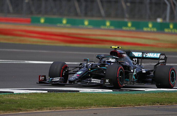 Mercedes driver Valtteri Bottas of Finland steers his car during the qualifying session at the 70th Anniversary Formula One Grand Prix at the Silverstone circuit, Silverstone, England, Saturday, Aug. 8, 2020. (AP Photo/Frank Augstein, Pool)