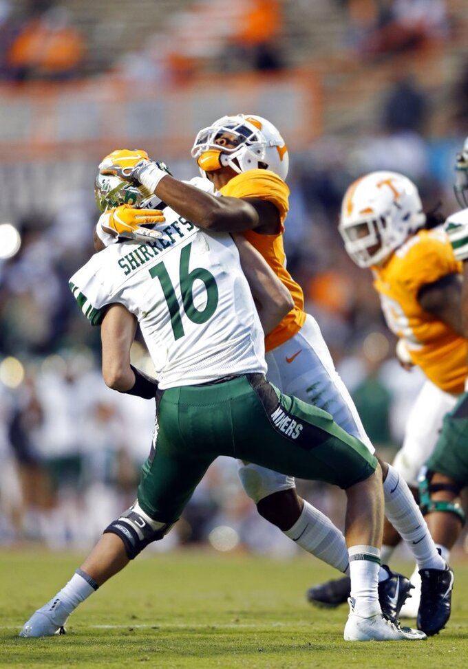Charlotte quarterback Evan Shirreffs (16) is sacked by Tennessee defensive back Bryce Thompson (20) in the second half of an NCAA college football game Saturday, Nov. 3, 2018, in Knoxville, Tenn. Tennessee won 14-3. (AP Photo/Wade Payne)