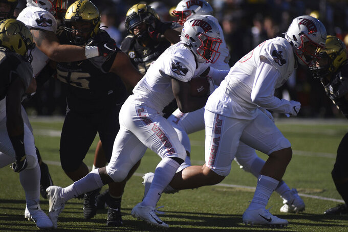 UNLV running back Charles Williams (8) runs against Vanderbilt in the first half of an NCAA college football game Saturday, Oct. 12, 2019, in Nashville, Tenn. (AP Photo/Mike Strasinger)