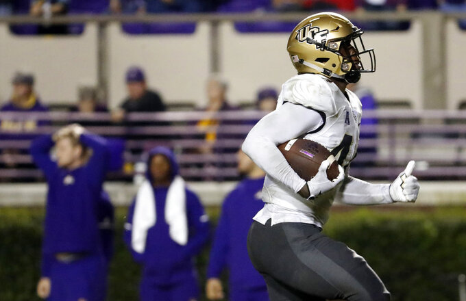 Central Florida's Nate Evans (44) returns a fumble for a touchdown during the second half of an NCAA college football game against East Carolina in Greenville, N.C., Saturday, Oct. 20, 2018. UCF won 37-10. (AP Photo/Karl B DeBlaker)