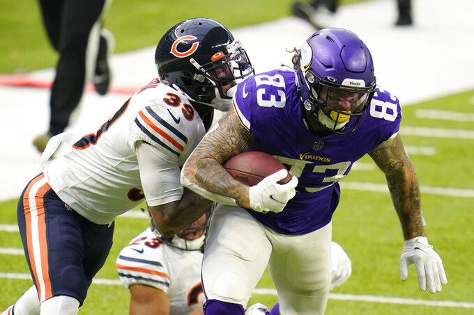 Minnesota Vikings tight end Tyler Conklin (83) is tackled by Chicago Bears safety Eddie Jackson (39) after catching a pass during the second half of an NFL football game, Sunday, Dec. 20, 2020, in Minneapolis. (AP Photo/Jim Mone)