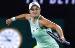 Australia's Ashleigh Barty celebrates after defeating Alison Riske of the U.S. during their fourth round singles match at the Australian Open tennis championship in Melbourne, Australia, Sunday, Jan. 26, 2020. (AP Photo/Andy Wong)
