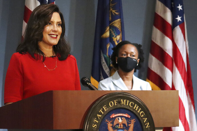 FILE - In this photo Sept. 16, 2020 file photo, provided by the Michigan Office of the Governor, Gov. Gretchen Whitmer addresses the state during a speech in Lansing, Mich. Gov. Whitmer says movie theaters and other entertainment venues can reopen after nearly seven months of closure during the coronavirus pandemic. She also has lifted a cap so more people in Michigan can attend funerals and other indoor events. The governor also issued an order Friday, Sept. 25, 2020, requiring all preK-12 students to wear masks in classrooms, beginning Oct. 5. (Michigan Office of the Governor via AP File)