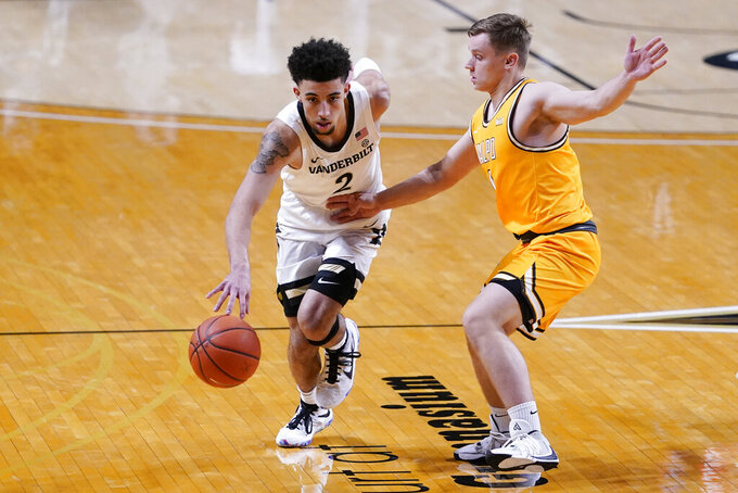 Vanderbilt guard Scotty Pippen Jr. (2) drives against Valparaiso guard Sigurd Lorange (1) in the first half of an NCAA college basketball game Friday, Nov. 27, 2020, in Nashville, Tenn. (AP Photo/Mark Humphrey)