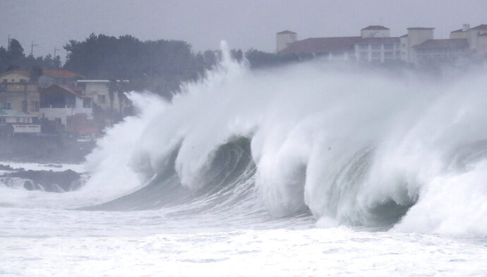High waves crash a shore as Typhoon Maysak approach on Jeju Island, South Korea, Wednesday, Sept. 2, 2020. An offshore typhoon brought torrents of rain to southern Japan on Wednesday heading to the Korean Peninsula. (Park Ji-ho/Yonhap via AP)