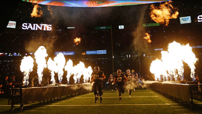 The New Orleans Saints are introduced before the NFL football NFC championship game against the Los Angeles Rams, Sunday, Jan. 20, 2019, in New Orleans. (AP Photo/Gerald Herbert)