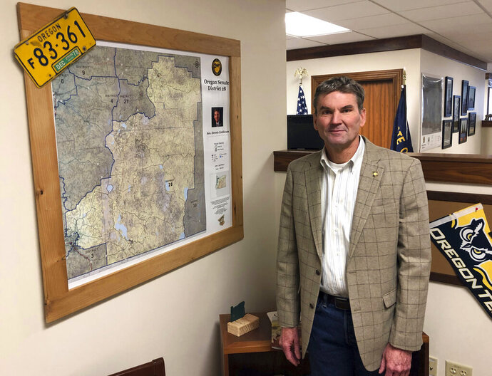FILE - In this Friday, Feb. 8, 2019 file photo, Oregon state Sen. Dennis Linthicum, R-Klamath Falls, poses in his office in the Oregon State Capitol in Salem, Ore. Linthicum said on Tuesday, April 9, 2019, that the designation of slaves as three-fifths of a person was not racist, drawing condemnation from at least two black lawmakers.  (AP Photo/Andrew Selsky, File)