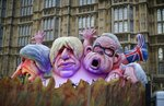 Effigies of British politicians from left, Prime Minister Theresa May, Boris Johnson and Michael Gove are driven on a truck by anti-Brexit, remain in the European Union supporters outside the Houses of Parliament in London, Thursday, March 14, 2019. British lawmakers faced another tumultuous day Thursday, as Parliament prepared to vote on whether to request a delay to the country's scheduled departure from the European Union and Prime Minister Theresa May struggled to shore up her shattered authority. (AP Photo/Matt Dunham)