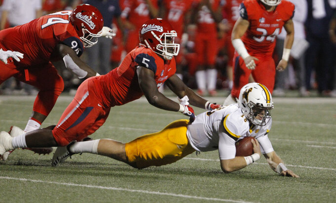 Wyoming quarterback Tyler Vander Waal is tackled by Fresno State defensive end Emeka Ndoh during the first half of an NCAA college football game in Fresno, Calif., Saturday, Oct. 13, 2018. (AP Photo/Gary Kazanjian)