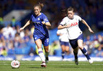 Chelsea's Maren Mjelde, left, and Tottenham Hotspur's Lucy Quinn battle for the ball during the Women's Super League soccer match at Stamford Bridge, London, Sunday Sept. 8, 2019. (John Walton/PA via AP)