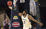 Liberty forward Myo Baxter-Bell grabs a one-handed rebound against Lipscomb during the first half of the Atlantic Sun conference NCAA basketball championship game in Lynchburg, Va., Sunday, March 8, 2020. (AP Photo/Lee Luther Jr.)