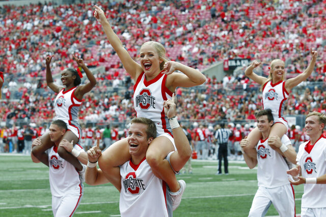 """FILE - In this Aug. 31, 2019, file photo Ohio State cheerleaders yell to fans during an NCAA football game against Florida Atlantic in Columbus, Ohio. A New York-based sports network has turned to the federal courts in its trademark dispute with Ohio State University over use of the letter """"O."""" (AP Photo/Paul Vernon, File)"""