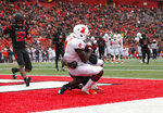 Illinois wide receiver Rick Smalling (4) hauls in a touchdown pass as Rutgers' Avery Young defends during the second half of an NCAA college football game Saturday, Oct. 6, 2018, in Piscataway, N.J. Illinois won 38-17. (AP Photo/David Boe)