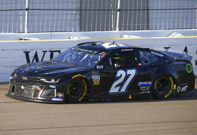 Joe Nemechek (27) drives during a NASCAR Cup Series auto race at the Las Vegas Motor Speedway on Sunday, Sept. 15, 2019. (AP Photo/Chase Stevens)