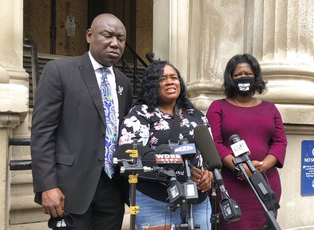 Tamika Palmer, mother of Breonna Taylor, addresses the media in Louisville, Ky. on  Thursday, Aug. 13, 2020.  Five months after her daughter was shot to death by police, Palmer said she is trying to be patient while waiting to hear if the officers will be charged.  (AP Photo/Dylan Lovan)
