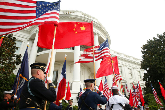 FILE - In this Sept. 25, 2015, file photo, a military honor guard await the arrival of Chinese President Xi Jinping for a state arrival ceremony at the White House in Washington. China on Tuesday, Dec. 8, 2020, lashed out at the U.S. over new sanctions against Chinese officials and the sale of more military equipment to Taiwan. (AP Photo/Andrew Harnik, File)