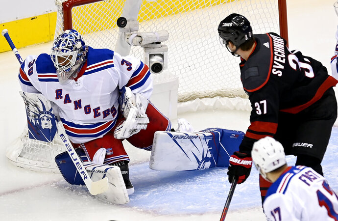 Carolina Hurricanes right wing Andrei Svechnikov (37) watches a goal is scored past New York Rangers goaltender Henrik Lundqvist (30) as Rangers right wing Jesper Fast (17) looks on during the first period in the NHL hockey Stanley Cup playoffs in Toronto, Saturday, Aug. 1, 2020. (Frank Gunn/The Canadian Press via AP)