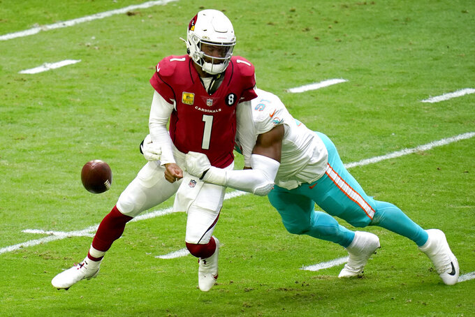 Miami Dolphins defensive end Emmanuel Ogbah (91) forces Arizona Cardinals quarterback Kyler Murray (1) to fumble during the first half of an NFL football game, Sunday, Nov. 8, 2020, in Glendale, Ariz. The Dolphins recovered for a touchdown. (AP Photo/Ross D. Franklin)