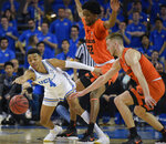 UCLA guard Jaylen Hands, left, loses the ball as Oregon State forwards Warren Washington, center, and Tres Tinkle defend during the first half of an NCAA college basketball game in Los Angeles, Thursday, Feb. 21, 2019. (AP Photo/Kelvin Kuo)