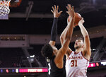 Southern California forward Nick Rakocevic, right, shoots as Colorado guard Tyler Bey defends during the first half of an NCAA college basketball game Saturday, Feb. 9, 2019, in Los Angeles. (AP Photo/Mark J. Terrill)