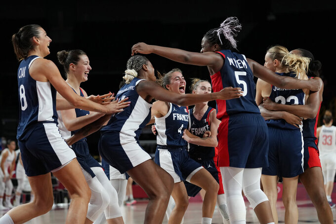 France players celebrate after their win over Serbia in a women's basketball bronze medal game at the 2020 Summer Olympics, Saturday, Aug. 7, 2021, in Saitama, Japan. (AP Photo/Eric Gay)