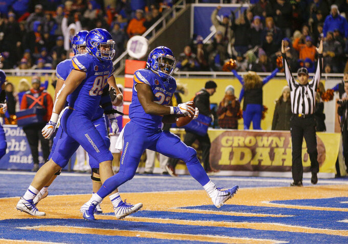 Boise State running back Alexander Mattison (22) celebrates a touchdown in the third quarter against Fresno State in an NCAA college football game, Friday, Nov. 9, 2018, in Boise, Idaho.Boise State won 24-17 over Fresno State (AP Photo/Steve Conner)