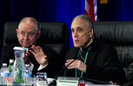 Cardinal Daniel DiNardo of the Archdiocese of Galveston-Houston, right, president of the United States Conference of Catholic Bishops, accompanied by Jose Gomez, archbishop of Los Angeles, speaks to the bishops before the morning prayer during the United States Conference of Catholic Bishops (USCCB), 2019 Spring meetings in Baltimore,  Tuesday, Jun 11, 2019. (AP Photo/Jose Luis Magana)