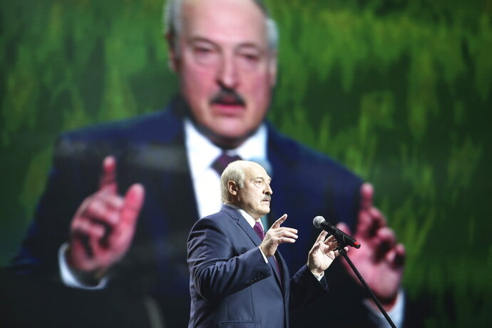 Belarusian President Alexander Lukashenko gestures as he addresses a women's forum in Minsk, Belarus, Thursday, Sept. 17, 2020. President Alexander Lukashenko's decision to close the borders with Poland and Lithuania underlines his repeated claim that the massive wave of protests is driven by the West and comes amid increasing criticism from the United States and the European Union. (TUT.by via AP)