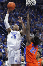 Kentucky's PJ Washington (25) shoots while pressured by Florida's Dontay Bassett (21) during the first half of an NCAA college basketball game in Lexington, Ky., Saturday, March 9, 2019. (AP Photo/James Crisp)