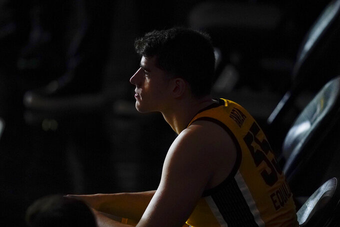 Iowa center Luka Garza sits on the bench before an NCAA college basketball game against North Carolina, Tuesday, Dec. 8, 2020, in Iowa City, Iowa. (AP Photo/Charlie Neibergall)