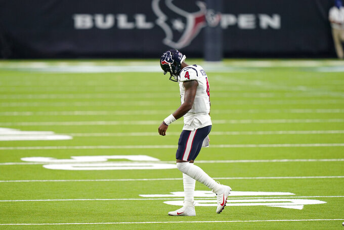 Houston Texans quarterback Deshaun Watson (4) walks off the field after failing to convert on a third down against the Baltimore Ravens during the second half of an NFL football game Sunday, Sept. 20, 2020, in Houston. (AP Photo/David J. Phillip)