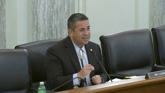 U.S. Sen. Ben Ray Luján, D-New Mexico, appears via a live-streamed hearing before a U.S. Senate subcommittee in Washington, D.C, regarding the challenges of combatting misinformation about COVID-19 vaccinations on Thursday, April 15, 2021. (AP Photo/Susan Montoya Bryan)